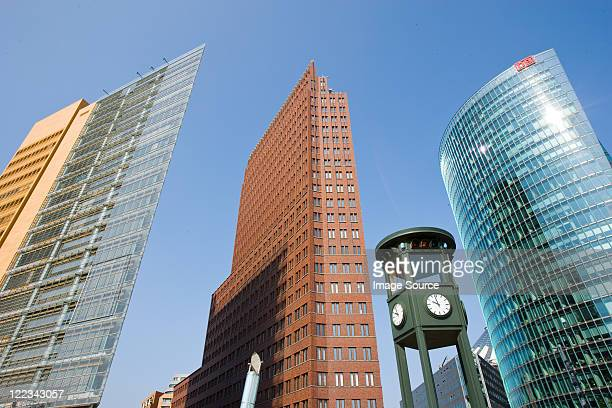 Clock tower and modern buildings, Potsdamer Platz, Berlin, Germany