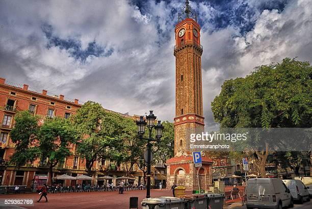 clock tower at placa de la vila de gracia - emreturanphoto stock pictures, royalty-free photos & images