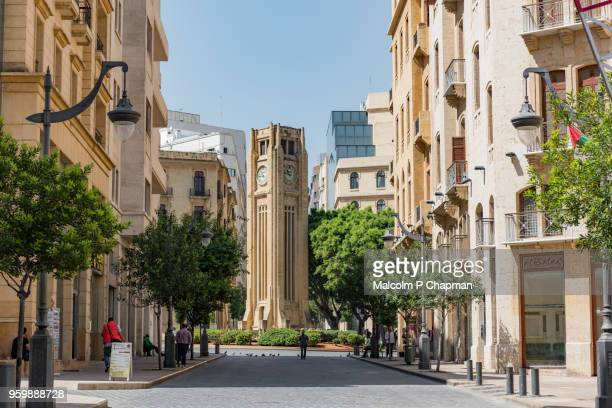 clock tower at rebuilt place de l'etoile, beirut, lebanon - beirut stock pictures, royalty-free photos & images