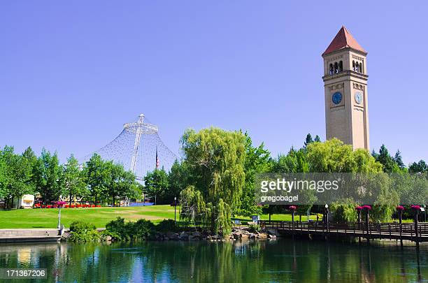 a clock tower at riverfront park in spokane on a sunny day - washington state stock pictures, royalty-free photos & images