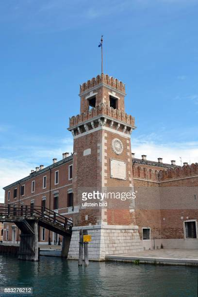 Clock tower at the entrance of the historic Venetian Arsenal and Naval Museum in Castello district of Venice in Italy. Caution: For the. Not for...