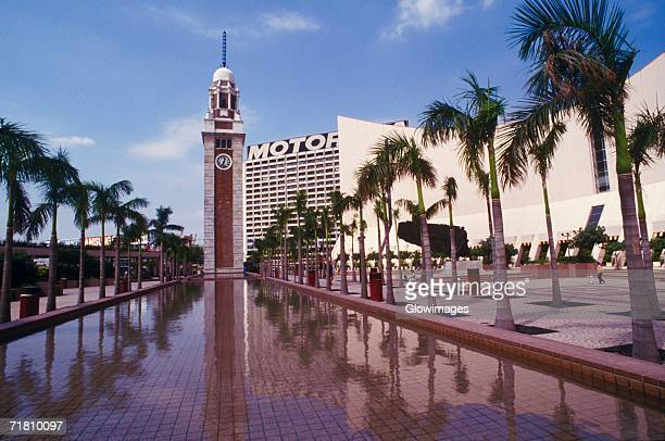 clock tower in front of a building, hong kong, china - tsim sha tsui stock pictures, royalty-free photos & images