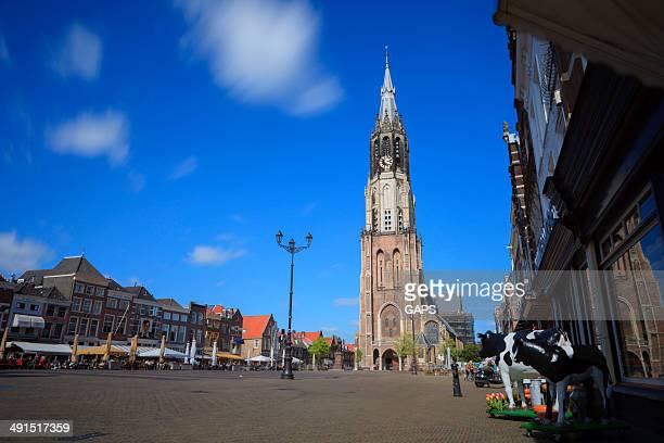clock tower of the nieuwe kerk in delft - nieuwe kerk delft stock photos and pictures