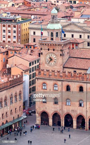 clock tower of the palazzo d'accursio in bologna - gwengoat stock pictures, royalty-free photos & images