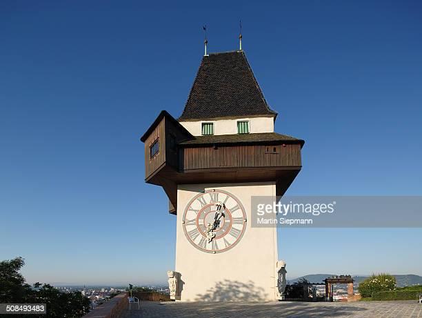 clock tower on schlossberg, castle hill, graz, styria, austria, europe, publicground - klokkentoren met wijzerplaat stockfoto's en -beelden