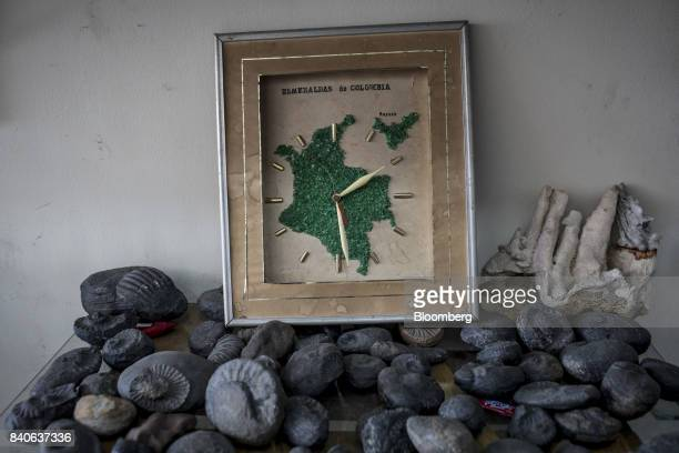 A clock with an emerald colored map of Colombia sits on display at a shop in Muzo Colombia on Saturday Aug 5 2017 Colombia is the world's largest...