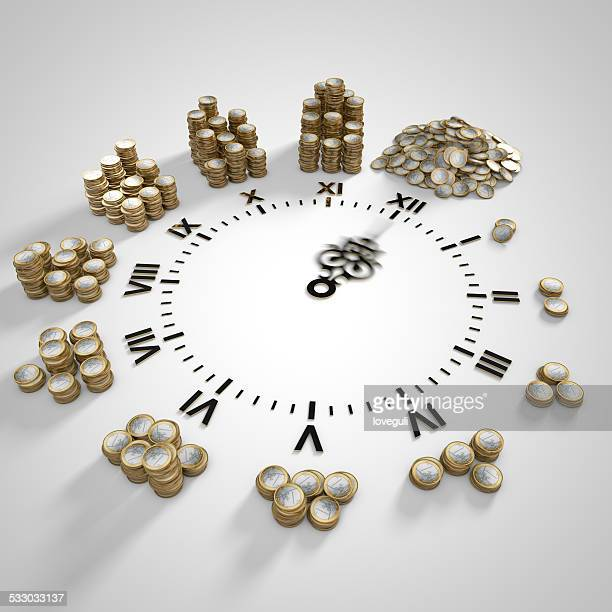 clock with stacks of coins,time is money concept.
