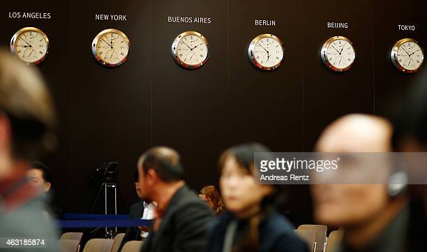 Clocks displaying the time in Los Angeles New York Buenos Aires Berlin Beijing and Tokyo are displayed at the 'Gone with the Bullets' press...