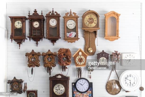 Clocks hang on a wall in a watchmaker's workshop on August 16 2018 in Weisswasser Germany
