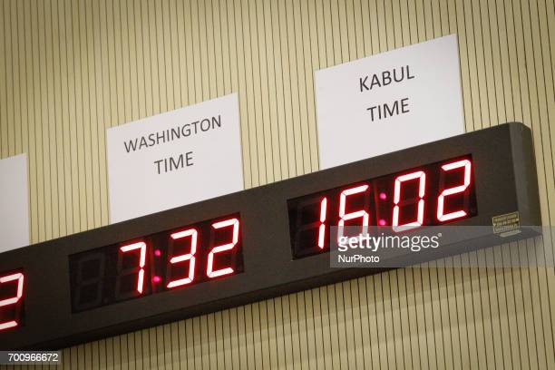 Clocks showing times in four different time zones are seen ahead of a press conference on the CWIX interoperability training weeks in Bydgoszcz...