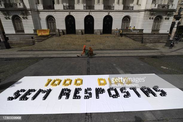 Clocks with the face of late councilwoman Marielle Franco form the words 1000 days without anwers outside the Municipal Chamber building of Rio de...
