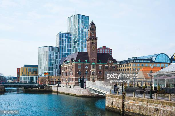 clocktower and office blocks on waterfront, malmo, sweden - malmo stock pictures, royalty-free photos & images
