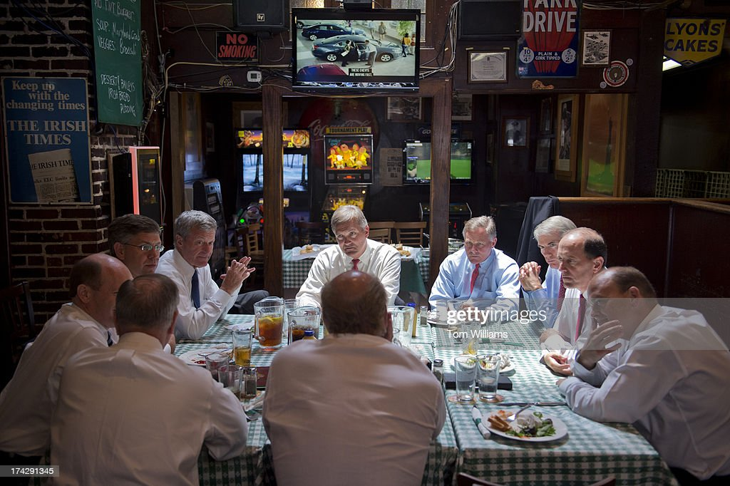 Clockwise from back center, Rep. Jim Matheson, D-Utah, Sens. Richard Burr, R-N.C., Rob Portman, R-Ohio, Reps. Dave Camp, R-Mich., Tom Reed, R-N.Y., Sens., John Delaney, D-Md., Lindsey Graham, R-S.C., Chris Coons, Erik Paulsen, R-Minn., and Sen. Max Baucus, D-Mont., gather for lunch at Irish Times to socialize and discuss tax reform issues. A bipartisan group occasionally gathers at the Capitol Hill watering hole where former Sen. Bob Packwood, R-Ore., met with his staff in 1986 to hash out tax reform legislation.