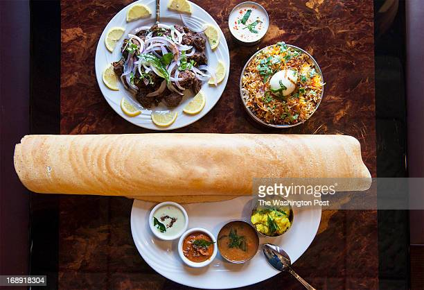Clockwise from bottom masala dosai lamb pepper fry and hyderabadi chicken biryani are photographed at Akshaya Thursday May 9 2013 in Sterling VA The...