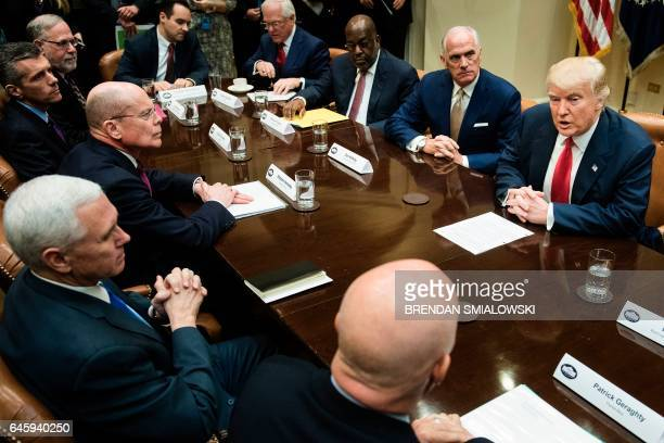 TOPSHOT Clockwise from bottom Patrick Geraghty CEO of Florida Blue US Vice President Mike Pence Stephen Hemsley CEO of UnitedHealth Group David...