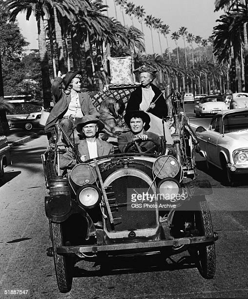 American actresses Donna Douglas and Irene Ryan and American actors Max Baer Jr and Buddy Ebsen drive in a convertible car in an episode of the...