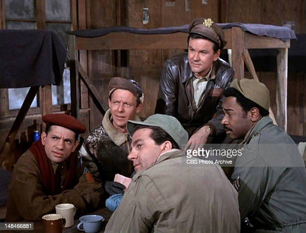 Clockwise from left Robert Clary as Cpl Louis LeBeau Larry Hovis as Sgt Andrew Carter Bob Crane as Col Robert E Hogan Ivan Dixon as Sgt James...