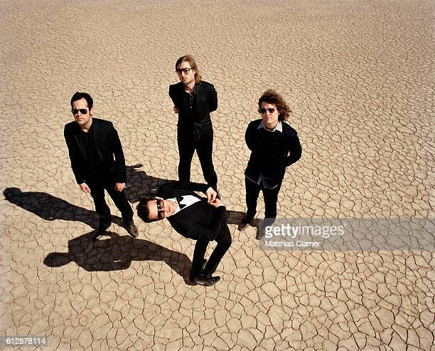 Ronnie Vannucci, Mark Stoermer, Dave Keuning and Brandon Flowers. Styling by Julie Ragolia. Grooming by Kumi Craig. On Brandon, light-blue...