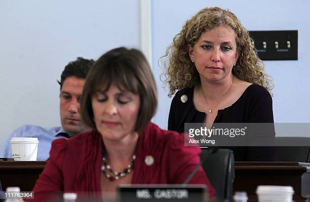 Clockwise from right US Rep Debbie Wasserman Schultz Rep Kathy Castor and Rep Tim Ryan pause during a markup hearing before the House Budget...