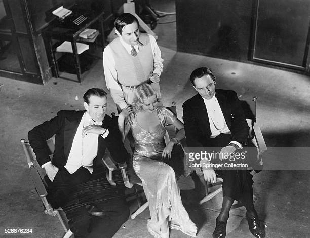 Director Ernst Lubitsch actor Frederic March actress Miriam Hopkins and actor Gary Cooper on the set of the 1933 movie Design for Living