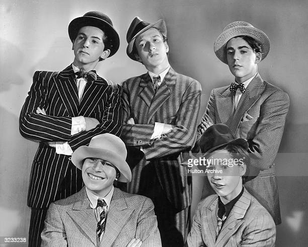 Clockwise from top left Actors Gabriel Dell Huntz Hall Billy Halop Bobby Jordan and Bernard Punsley known as the Dead End Kids wear suits and hats...