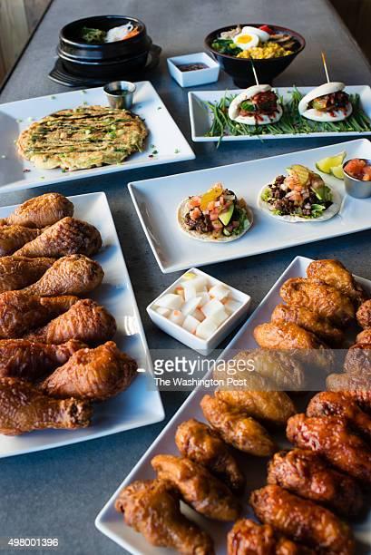 Clockwise from top left is Bulgogi Hot Stone Bibimbap $1599 Miso Ramen $1199 spicy pork buns $899 Bulgogi Tacos $799 Momo's Korean Fried Chicken...