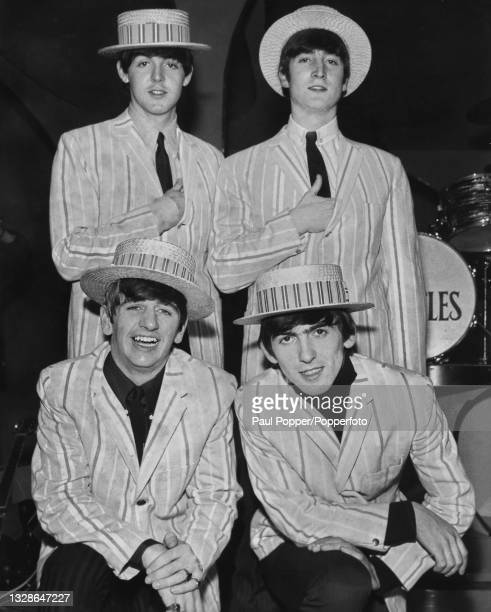 Clockwise from top left, Paul McCartney, John Lennon , George Harrison , and Ringo Starr of English pop group The Beatles posed together wearing...