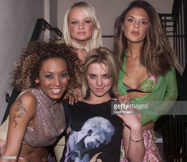Clockwise from top left Spice Girls Emma Bunton Victoria Beckham Melanie C and Mel B at the Red Cube club in Leicester Square London on November 6...