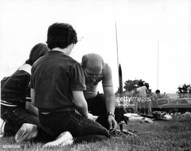 Clockwise from top left students teachers and parents watch blastoff Curtis Heller and Beth Kellett assemble rocket Sean Bergins makes rocket and...