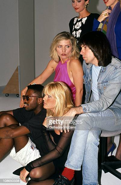 Clockwise from top right: Dianne Brill, Johnny Ramone , Patti Hansen, unidentified, Debbie Harry, unidentified pose for a group portrait at Hair...