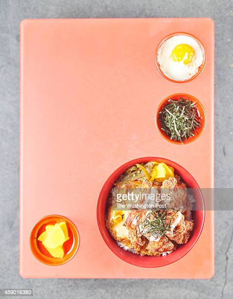Clockwise Onsen egg Kizami Nori Karaagedon and Takuan photographed at Donburi in Washington DC