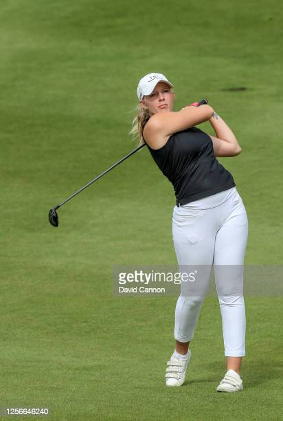 Cloe Frankish of England plays her second shot on the 18th hole during The Rose Ladies Series at the JCB Golf and Country Club on July 16 2020 in...