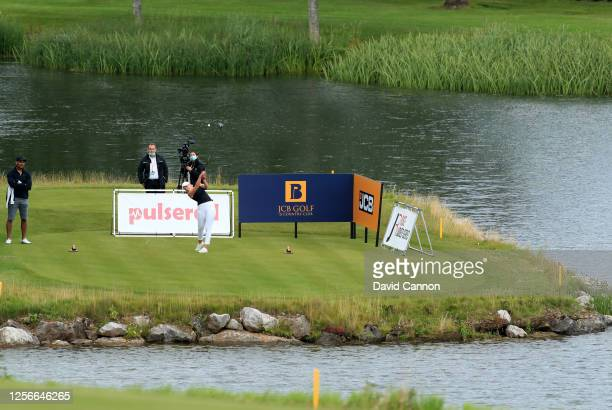 Cloe Frankish of England plays her tee shot on the 18th hole during The Rose Ladies Series at the JCB Golf and Country Club on July 16 2020 in...