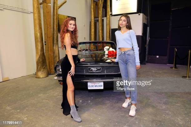 Cloe Wilder and Alessia Degraye attend Cloe Wilder's Save Me music video premiere party on October 08 2019 in Los Angeles California