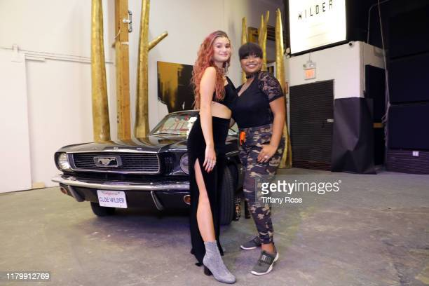 Cloe Wilder and Amber Lourdes attend Cloe Wilder's Save Me music video premiere party on October 08 2019 in Los Angeles California