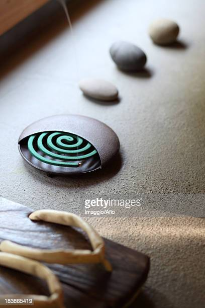 clogs and mosquito coil - incense coils stock pictures, royalty-free photos & images