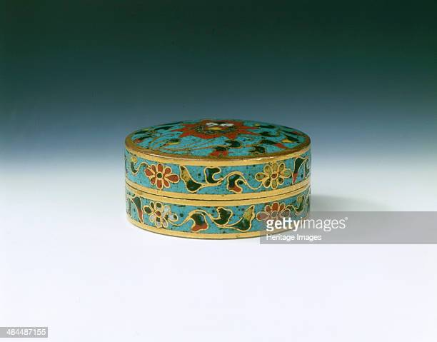 Cloisonne enamel covered box with lotus design Ming dynasty China late 15th century A small round red brass cloisonne pill or seal paste box The top...