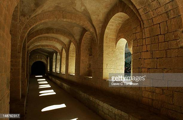 cloister of the abbey church, st guilhem-le-desert. - herault stock pictures, royalty-free photos & images