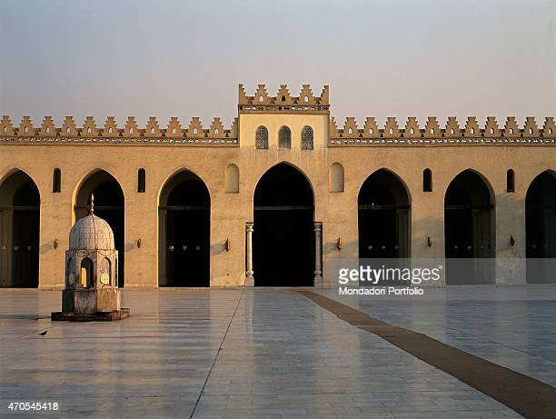 'Cloister of the alHakim Mosque by Fatimid craftsmen 928992 10th Century Marble and sandstone Egypt Cairo Detail The still low sun enlights the...