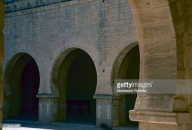 'Cloister of the Great Mosque by Aghlabids craftsmen 9th Century Sandstone wall Tunisia Sousse Great Mosque Detail Three horseshoe arches in the...