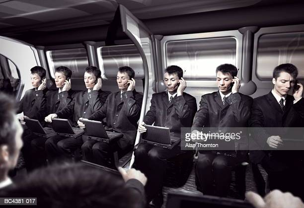 cloned executives in train carriage (digital composite) - cloning stock pictures, royalty-free photos & images