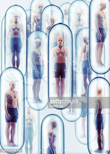 Cloned men standing in capsules, wearing shorts (Digital Composite)