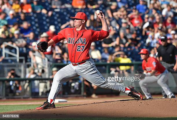 JC Cloney of the Arizona Wildcats delivers a pitch against the Coastal Carolina Chanticleers in the first inning during game one of the College World...