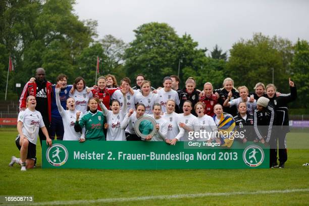 Cloppenburg players celebrate with the championship trophy after the Women's Second League match between Herforder SV and BV Cloppenburg at...