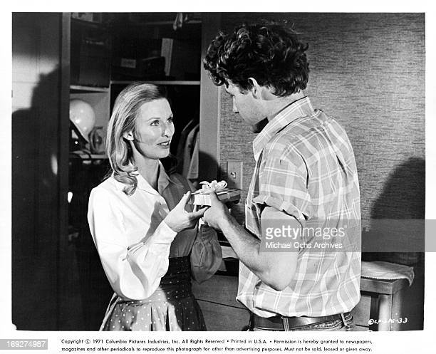 Cloris Leachman offering present to Timothy Bottoms in a scene from the film 'The Last Picture Show' 1971
