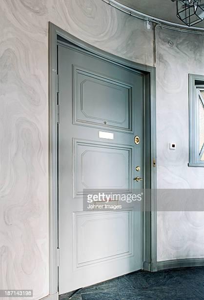 Close entrance door at home
