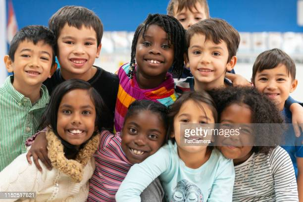 close friends in class portrait - primary school child stock pictures, royalty-free photos & images