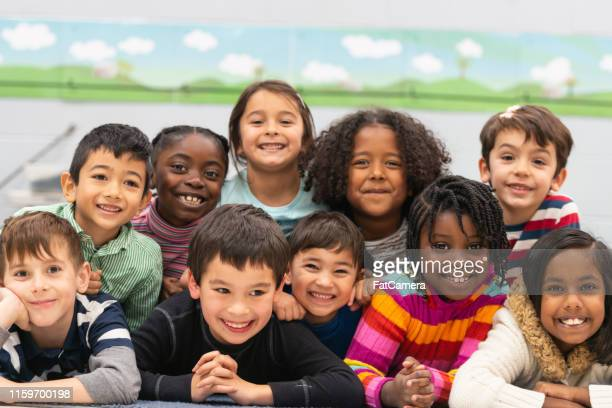 close friends in class portrait - affectionate stock pictures, royalty-free photos & images