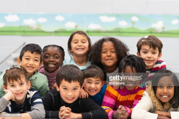 close friends in class portrait - children only stock pictures, royalty-free photos & images