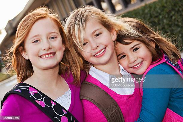 Close Girl Friends Outside Elementary School  Building